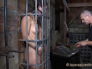 brunette hair bondservant gagged in cage