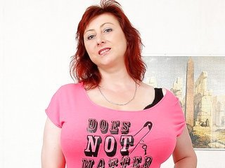 attractive red haired beauty is exposing her indeed fatter breasts
