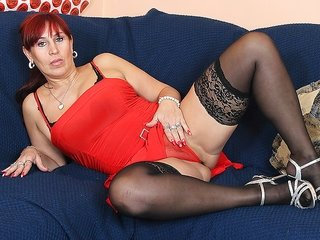 brunette hair mature lady in a red outfit is playing with herself ribald