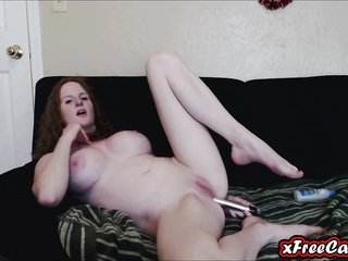 curvacious redhead MILF fools around her solid asshole on webcam