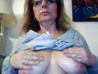 Old hottie teases her muff, rubs bazookas