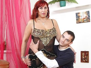 Red haired ripened gal is engulfing a well-built boner deep